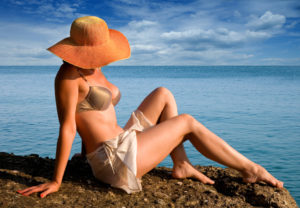 Woman-hat-on-beach-Courtesy-PrivateRX-LO-300x208